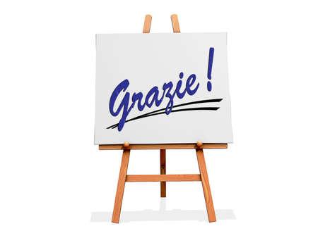 agradecimiento: Art Easel sobre un fondo blanco con Gracias en italiano Foto de archivo