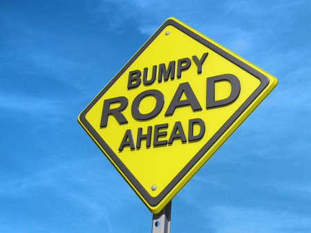bumpy: A yield road sign with  Stock Photo