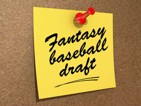 A note pinned to a cork board with the text Fantasy Baseball Draft  Stock Photo