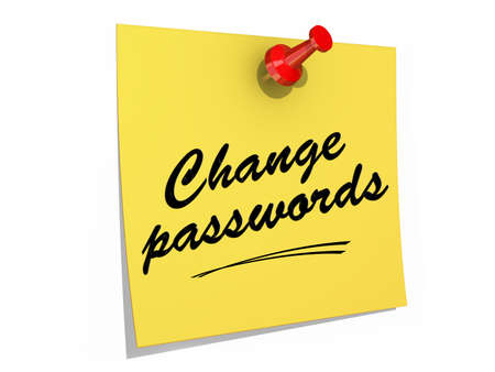 A note pinned to a white background with the text Change Passwords  Stock Photo