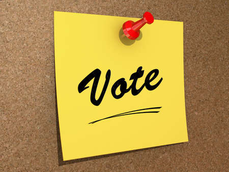 A note pinned to a cork board with the text Vote. Stock Photo