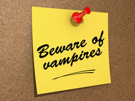 A note pinned to a cork board with the text Beware of Vampires Reklamní fotografie - 19327590