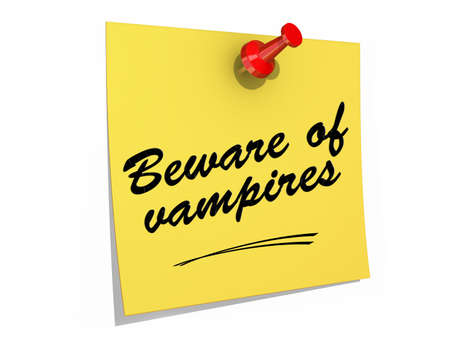 A note pinned to a white background with the text Beware of Vampires  Reklamní fotografie