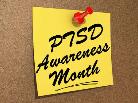 A note pinned to a white background with the text PTSD Awareness Month  版權商用圖片