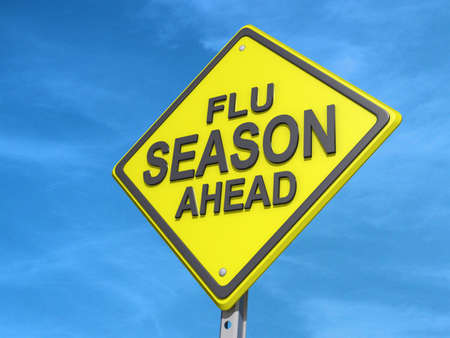 A yield road sign with Flu Season Ahead Stock Photo