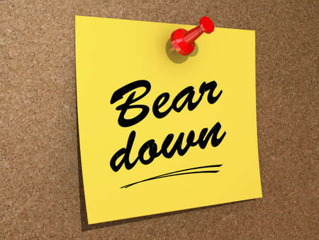 A note pinned to a cork board with the text Bear Down. Stock Photo