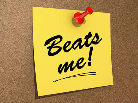 A note pinned to a cork board with the text Beats Me! Stock Photo
