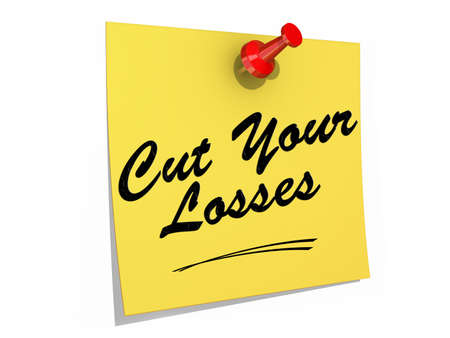 A note pinned to a white background with the text Cut Your Losses. Banco de Imagens