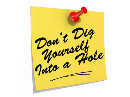 sabotage: A note pinned to a white background with the text Dont Dig Yourself Into a Hole. Stock Photo