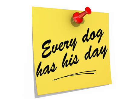 A note pinned to a white background with the text Every Dog Has His Day  Banco de Imagens