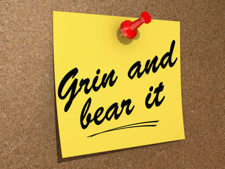 A note pinned to a cork board with the text Grin and Bear It Stock Photo - 19454885