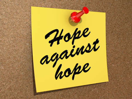 A note pinned to a cork board with the text Hope Against Hope Stock Photo - 19454886