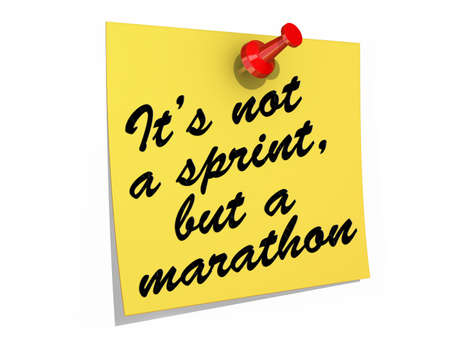 A note pinned to a white background with the text Its Not a Sprint, But a Marathon.