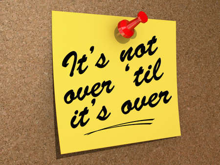 A note pinned to a cork board with the text It's Not Over 'Til It's Over. Stock Photo - 19454887