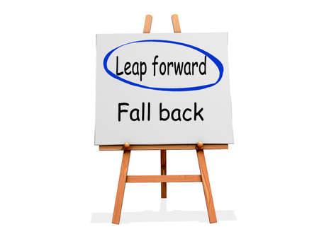 Leap Forward Not Fall Back on a sign. Stock Photo