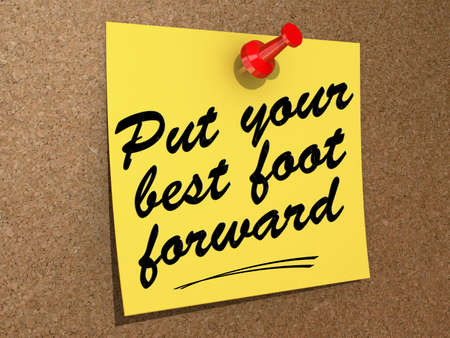 A note pinned to a cork board with the text Put Your Best Foot Forward. Stok Fotoğraf