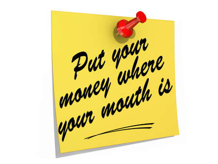 A note pinned to a white background with the text Put Your Money Where Your Mouth Is. Stock Photo