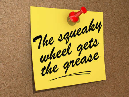 A note pinned to a cork board with the text The Squeaky Wheel Gets the Grease Imagens - 19832009