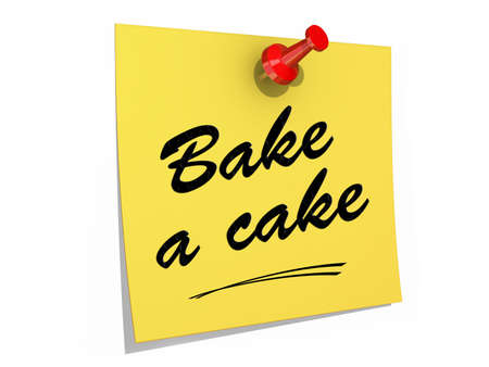A note pinned to a white background with the text Bake a Cake. Stock Photo