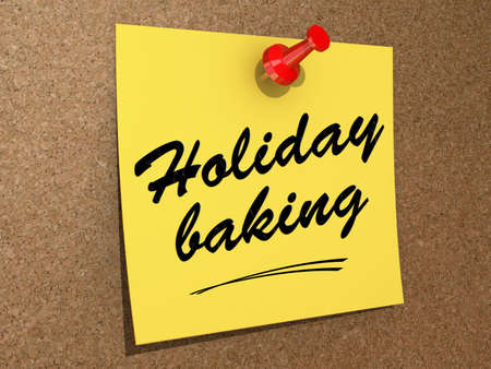 A note pinned to a cork board with the text Holiday Baking. Stock Photo
