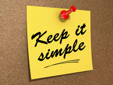 A note pinned to a cork board with the text Keep It Simple. Stock Photo
