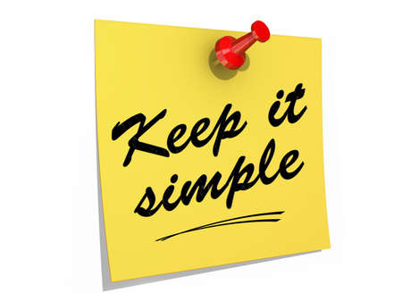 A note pinned to a white background with the text Keep It Simple. Stock Photo
