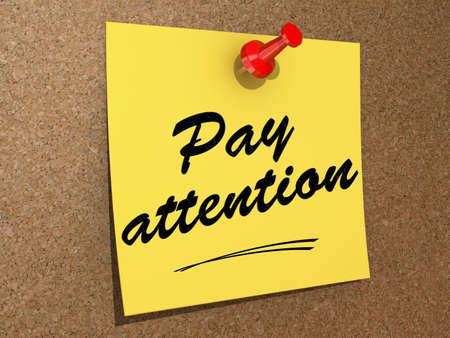 poner atencion: Una nota clavada en un tablero de corcho con el texto Pay Attention Foto de archivo
