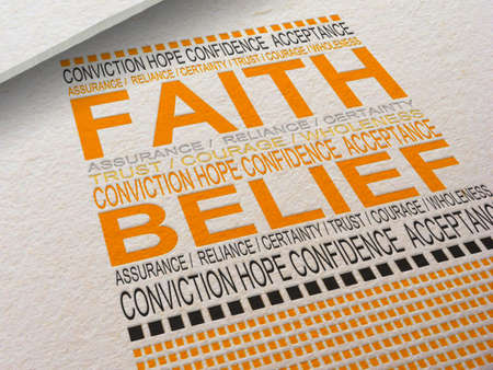 The word Faith letterpressed into paper with associated words around it