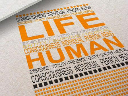 Het woord Leven Letterpressed in papier met bijbehorende woorden eromheen Stockfoto