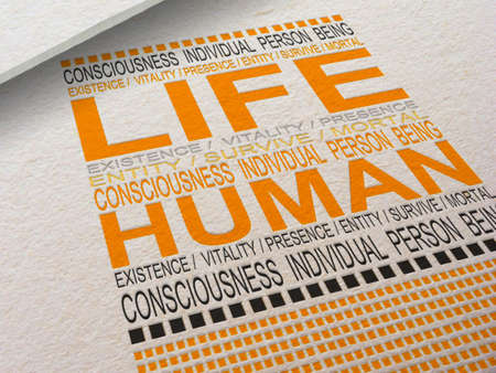 The word Life letterpressed into paper with associated words around it