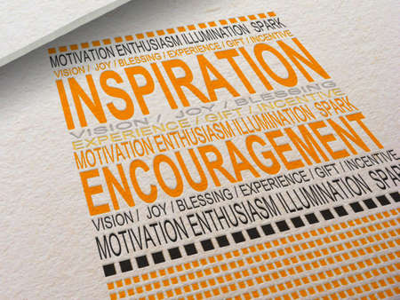 The word Inspiration letterpressed into paper with associated words around it.