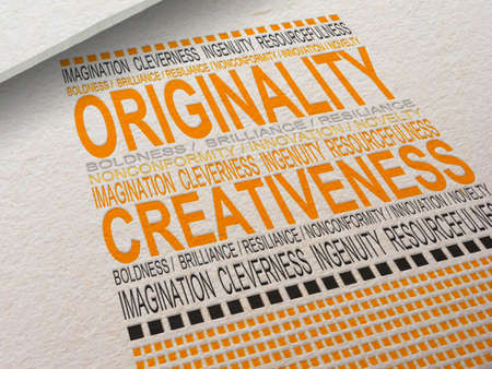 The word Originality letterpressed into paper with associated words around it. Banco de Imagens