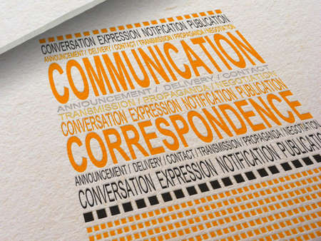 The word Communication letterpressed into paper with associated words around it. Stock Photo