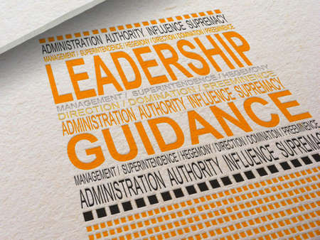 The word Leadership letterpressed into paper with associated words around it. Stock Photo