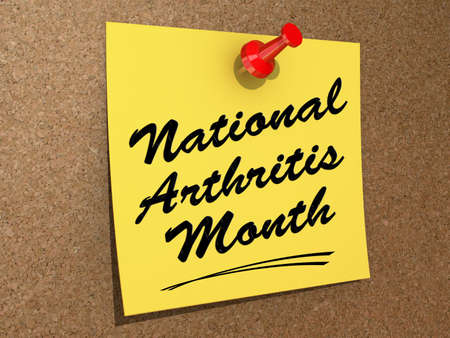 A note pinned to a cork board with the text  National Arthritis Month