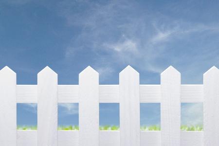 beautiful white fence and blue sky photo