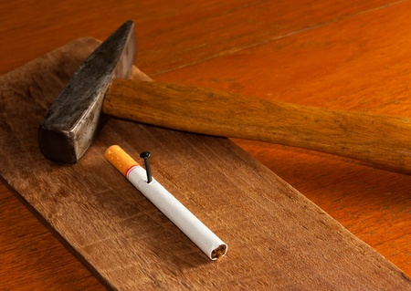 fag: Cigarette impaled on wood