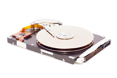 Open harddisk isolated on white background, focus on the middle of the disk photo