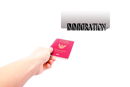 hand give passport to immigration  photo