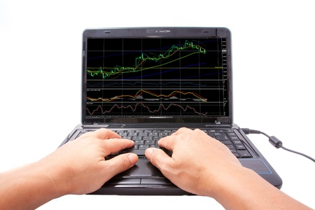 one computer notebook with doji graph and indicator Stock Photo