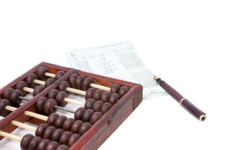 cash flow statement: bank passbook with abacus and fountain pen Stock Photo