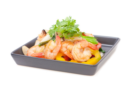 stir fried shrimp with bell pepper isolated on white