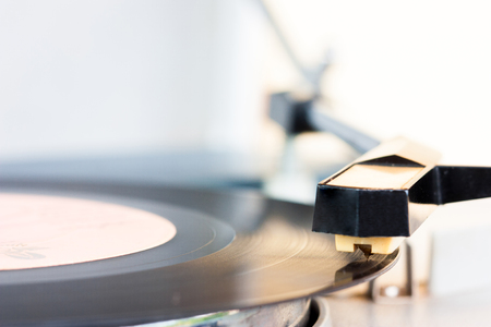 phonograph: ancient audio disc while playing focus on a phonograph needle Stock Photo