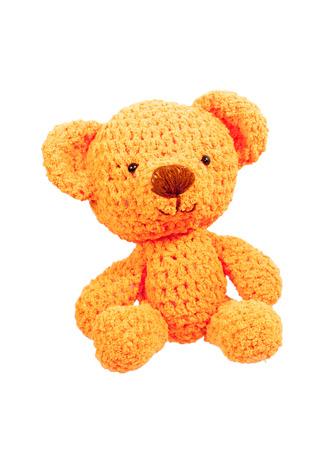 orange bear crochet doll isolated on white