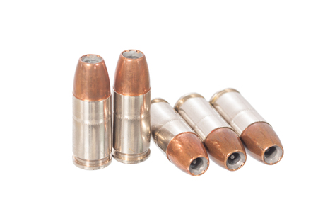 9mm: 9mm bullet isolated on white