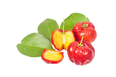 open to show inside of acerola fruit with leaf isolated on white
