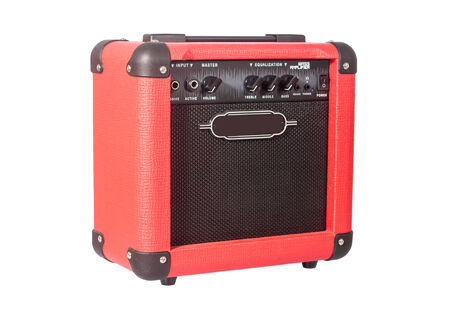 red bass guitar amplifier isolated on white photo