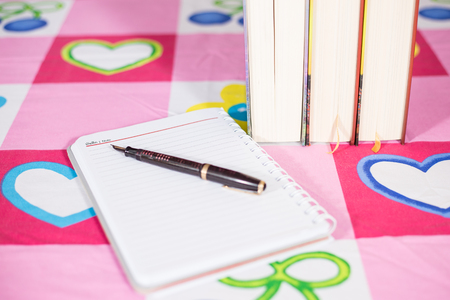 pen book and notebook on the table Stock Photo