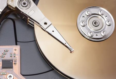 open harddisk to show disk arm and head photo