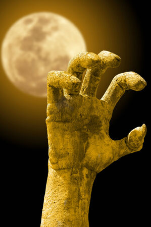 evil hand bruning with fullmoon background